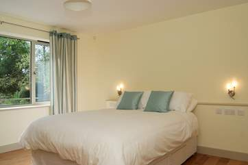 Bedroom 1 has a 5' double bed, an en suite bathroom, and is on the ground floor.