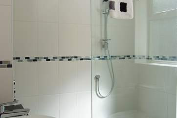 There is a walk-in shower in the en suite bathroom on the ground floor.