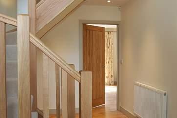 The bespoke turning oak staircase.