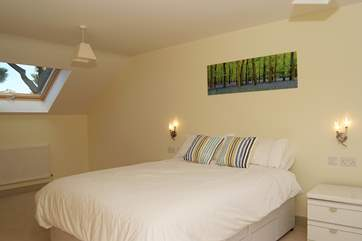 Bedroom 2 is extremely spacious, with a 5' bed, a sitting-area with a TV/DVD player and an en suite shower-room.