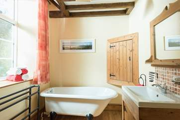 The ground floor family bathroom is complete with roll top bath to relax and soak after a day out exploring.