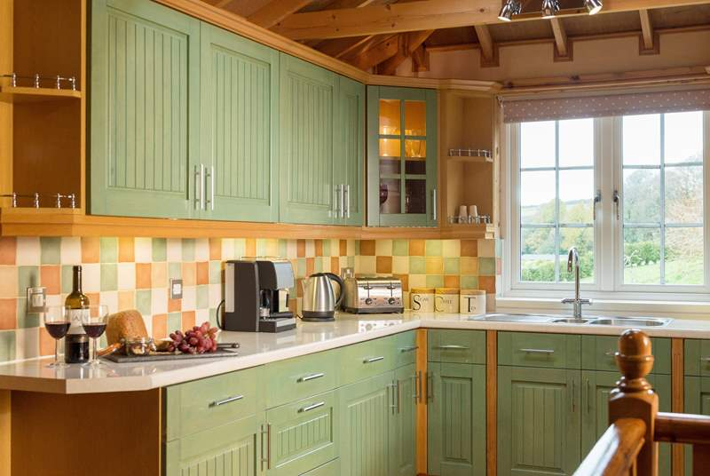 The spacious kitchen has wonderful views across the surrounding gardens.