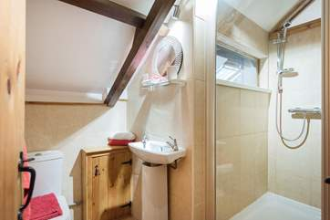 The en-suite shower room to Bedroom 4.