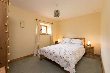 This is the second bedroom with its double bed. This bedroom also has views across the gardens and the valley.