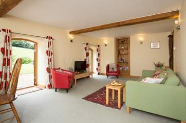 There is a really spacious living/dining room with two sets of French windows to the gardens.