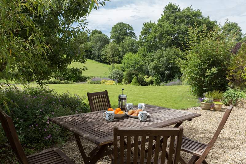 There is a gorgeous terrace overlooking the gardens and the countryside beyond.