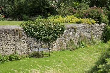 There is a little hidden away seat by the stream.  Perfect for that evening glass of wine.
