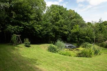 There are extensive grounds here - tucked away out of sight is this lovely lawned area with a wildlife pond.