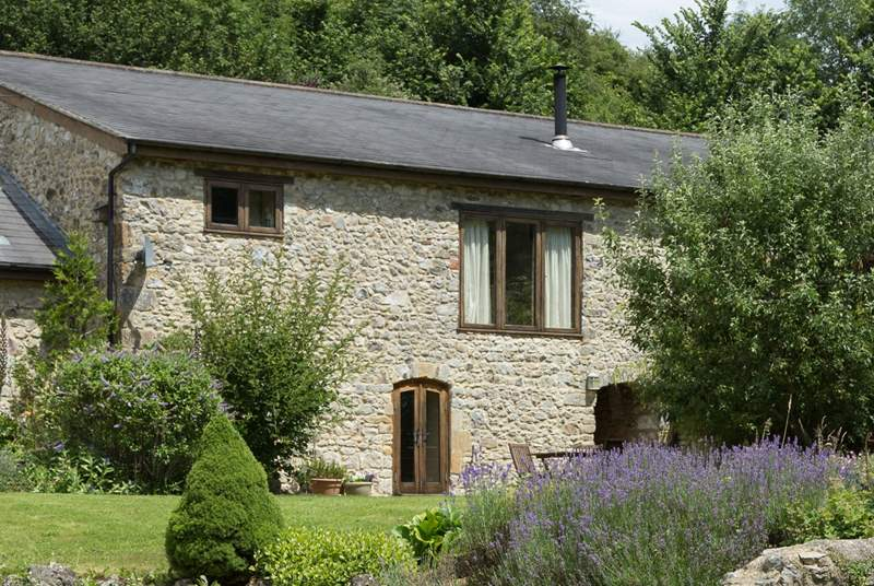 Purtington Barn Cottage has a beautiful outlook over the gardens which include a little stream and a wildlife pond where you can sit in peace and quiet.