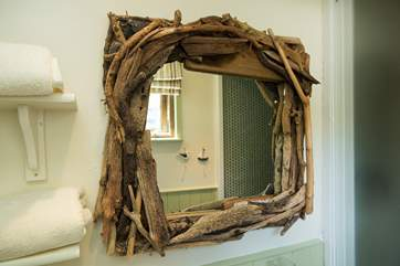 There are reminders throughout about the name... a driftwood mirror.