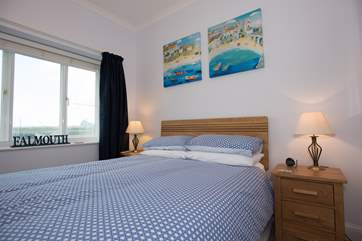 The bedroom looks out towards the lifeboat station.