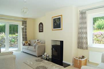 The sitting-room includes a welcoming wood-burner.