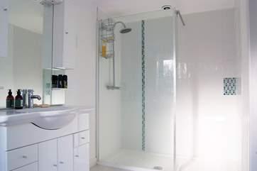 Bedroom 2's en suite shower-room includes a large walk-in shower.