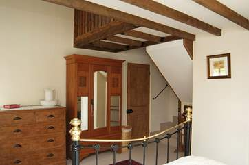 Stairs in the double bedroom go up to the galleried single bedroom above.