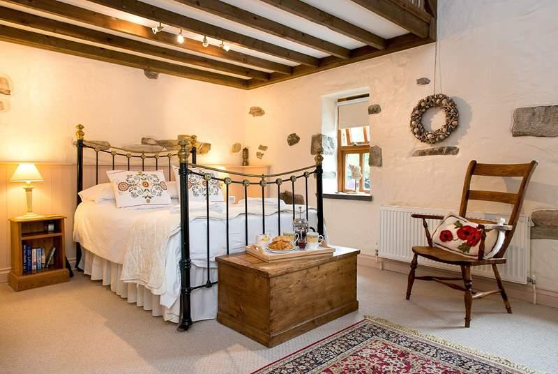 Bedroom 1 has a beautiful bedstead.