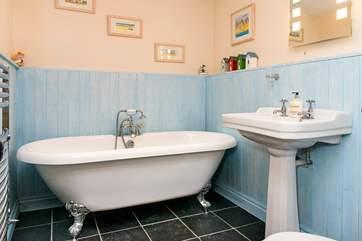 The main bathroom has a gorgeous free-standing bath.