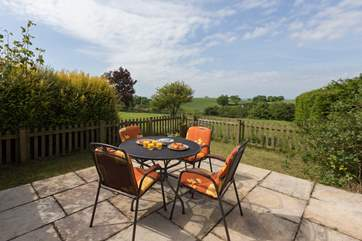 Outside there is an enclosed patio with rural views beyond the owner's garden. The patio is very private.