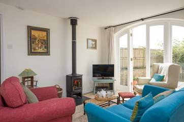 There is a really homely living room with a wood burning stove for out of season breaks.
