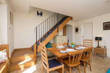 The open plan layout of the ground floor has plenty of room for this farmhouse dining table