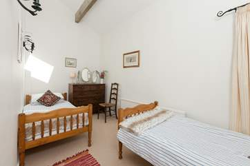 This is the twin bedroom also on the ground floor. There is a bathroom just across the corridor.