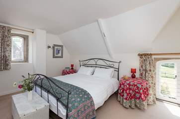 Upstairs is a further double bedroom, a high ceilinged spacious room with a super-king sized bed