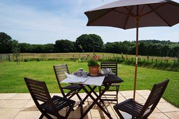 The patio and garden look out over fields and to the countryside beyond. A beautiful place to start and end the day.