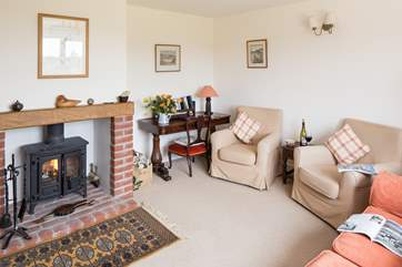 The sitting room has a cosy wood burner, making this a great place to stay all year round.
