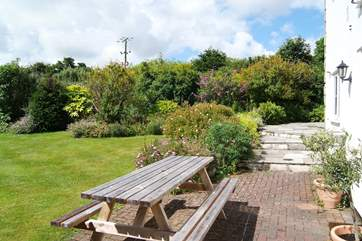 The perfect spot for a bit of al fresco dining with views of the lovely garden.