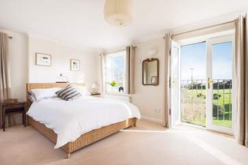 Bedroom 2 also has a Juliet balcony with lovely views across the countryside to Falmouth Bay.