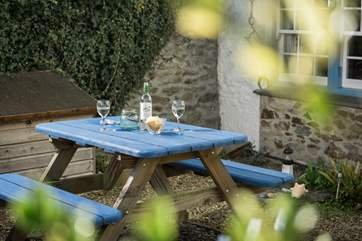 Sit in the courtyard and enjoy a peaceful glass of wine.