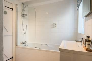 There is a fitted shower over the bath.