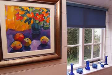 The cottage is full of character with lovely paintings and a seaside theme.