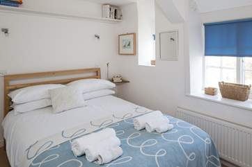 The double bedroom enjoys views across the town.