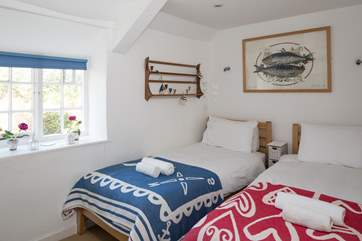 The twin bedroom looks out over the pedestrian lane, with 3ft twin beds.