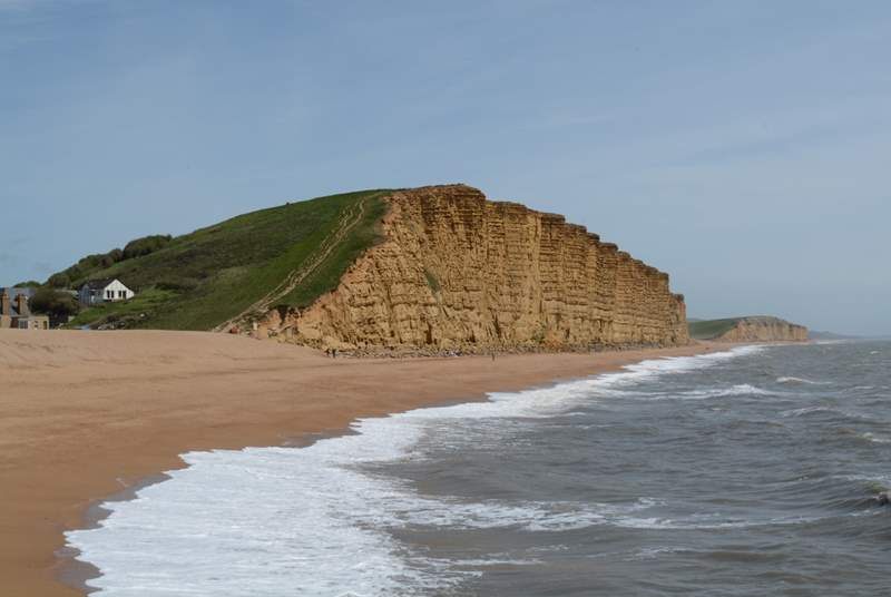 The beach at West Bay shows the dramatic cliffs, but beware of coastal erosion.