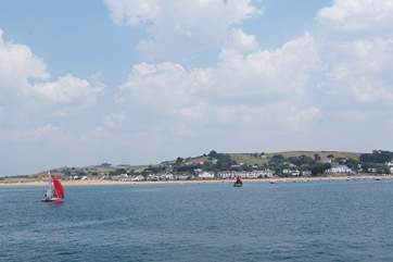 Sea Cottage is tucked away in the sand dunes to the left of this photograph of Instow.