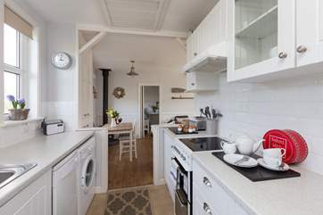 The galley-style kitchen is extremely well-equipped and leads through into the main living area.