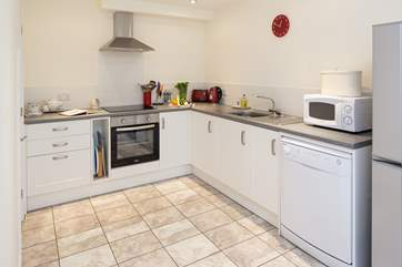 The kitchen is very well-equipped with a large pantry in the corner.
