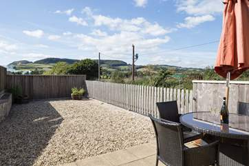Enjoy eating outside on this fabulous patio, with views right across to Golden Cap.