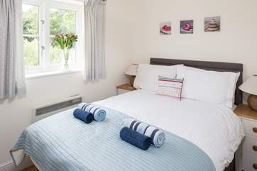 The compact bedroom has a super comfy double bed.