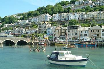 Boats in the harbour at nearby Looe, from where you can book fishing trips.