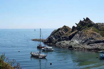 Boats waiting for the tide to rise to go into Polperro harbour.