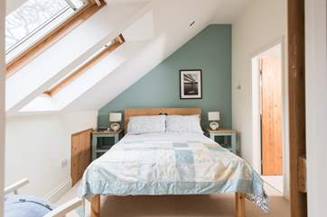 The bedroom...take care with the sloping ceiling on one side of the bed.