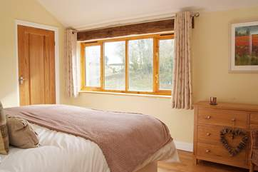 The second bedroom is light and spacious and has a built-in wardrobe.