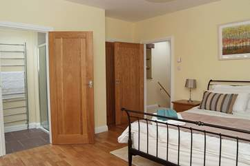 The master bedroom has built-in wardrobes and oak floors (Bedroom 1).