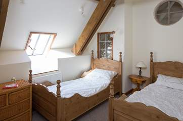 Bedroom 2 has wooden twin beds.
