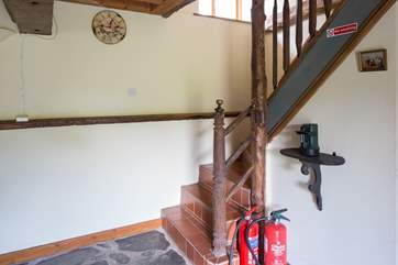 The stairs up to the first floor.