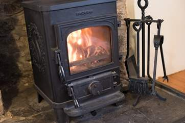 The roaring wood-burner, there are two.