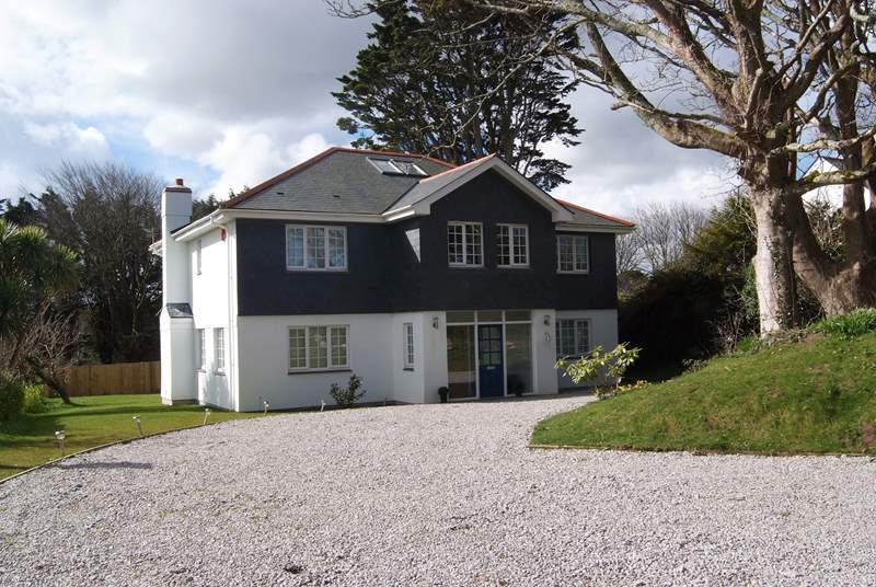 Trelandry is a large detached house set in attractive enclosed gardens.