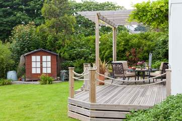 You have three steps that take you down from the lovely deck to the lawn.